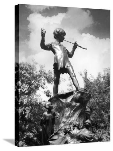 The Peter Pan Monument was Erected-J^ Chettleburgh-Stretched Canvas Print