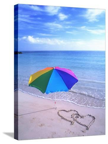 Umbrella on the Beach with Hearts Drawn in the Sand-Bill Bachmann-Stretched Canvas Print