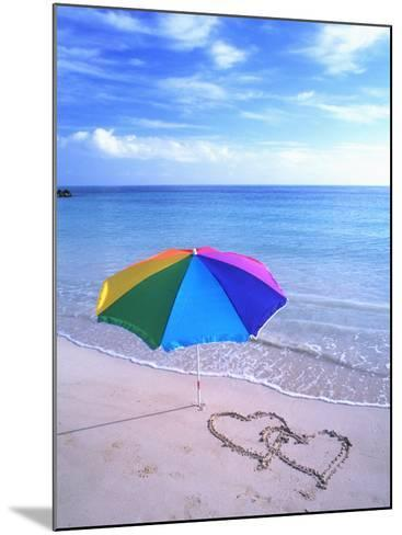 Umbrella on the Beach with Hearts Drawn in the Sand-Bill Bachmann-Mounted Photographic Print