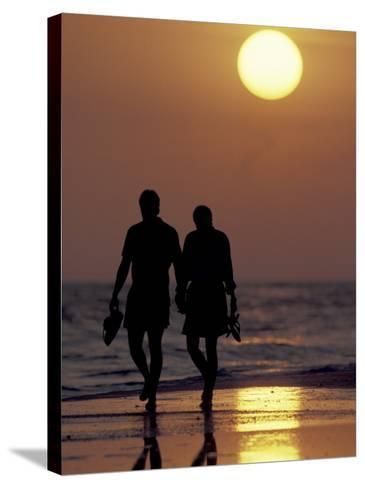 Couple Walking on Beach at Sunset, Sarasota, Florida, USA-Maresa Pryor-Stretched Canvas Print