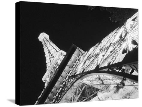 Eiffel Tower and Paris Casino at Night, Las Vegas, Nevada, USA-Walter Bibikow-Stretched Canvas Print