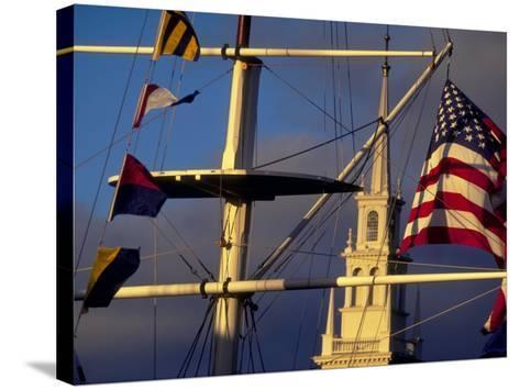 Trinity Church Behind Flags at Bowen's Wharf, Newport, Rhode Island, USA-Alexander Nesbitt-Stretched Canvas Print