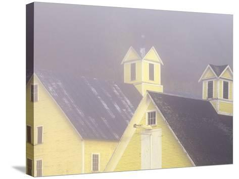 Foggy Morning and Yellow Barn near White River Junction, Vermont, USA-Darrell Gulin-Stretched Canvas Print