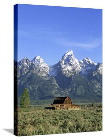 Morning Light on the Tetons and Old Barn, Grand Teton National Park, Wyoming, USA-Howie Garber-Stretched Canvas Print