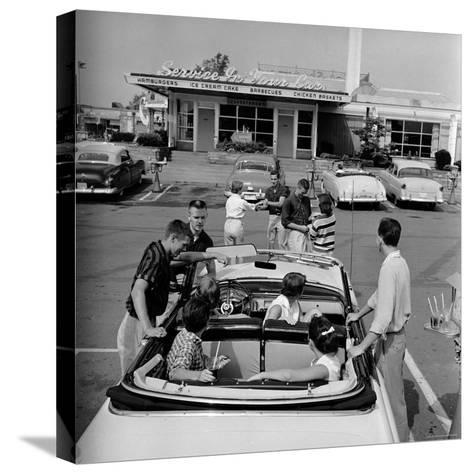 Teenagers Hanging Out at the Local Drive In-Hank Walker-Stretched Canvas Print