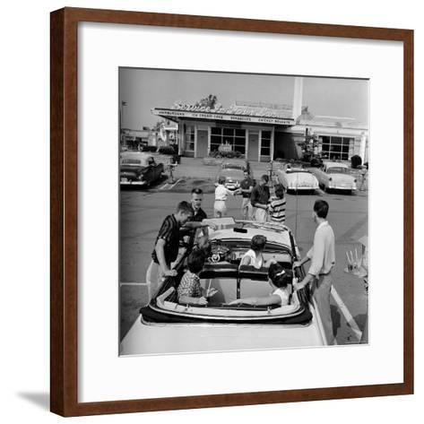 Teenagers Hanging Out at the Local Drive In-Hank Walker-Framed Art Print