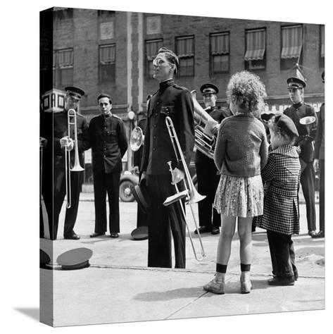 The Salvation Army Band Playing Their Instruments on the City Street-Bernard Hoffman-Stretched Canvas Print