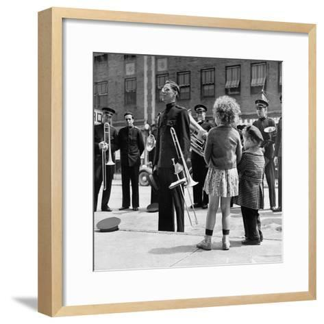 The Salvation Army Band Playing Their Instruments on the City Street-Bernard Hoffman-Framed Art Print