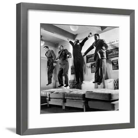 The Salesmen Showing How Not to Test a Bed at Lewis and Conger-George Silk-Framed Art Print