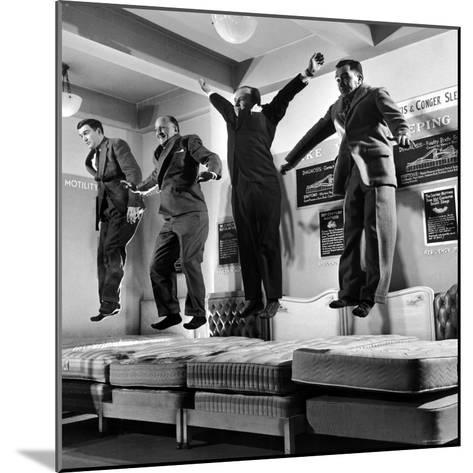 The Salesmen Showing How Not to Test a Bed at Lewis and Conger-George Silk-Mounted Photographic Print