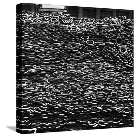 Pile of New and Used Tires over 40 Feet Deep at the B.F. Goodrich Yard-William C^ Shrout-Stretched Canvas Print