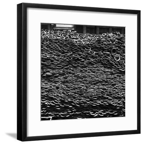 Pile of New and Used Tires over 40 Feet Deep at the B.F. Goodrich Yard-William C^ Shrout-Framed Art Print