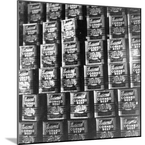 Canned Corn Beef Waiting to Be Exported-Hart Preston-Mounted Photographic Print