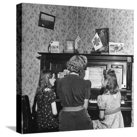 Patricia Colleen Altree Playing the Piano with Her Two Sisters-J^ R^ Eyerman-Stretched Canvas Print