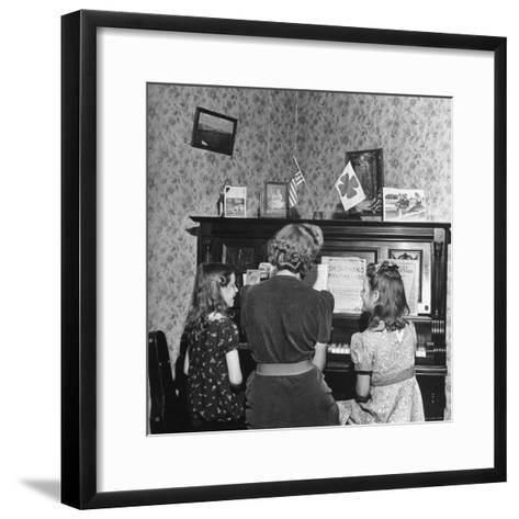 Patricia Colleen Altree Playing the Piano with Her Two Sisters-J^ R^ Eyerman-Framed Art Print