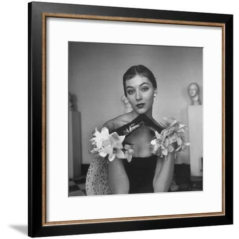 Model Wearing a Flowery Glove While Peering Into the Distance-Nina Leen-Framed Art Print