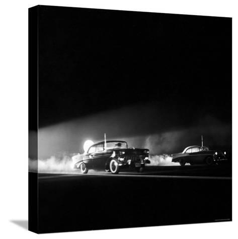 Two Cars in Drag Race-Hank Walker-Stretched Canvas Print