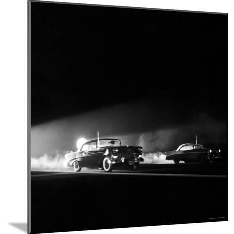 Two Cars in Drag Race-Hank Walker-Mounted Photographic Print