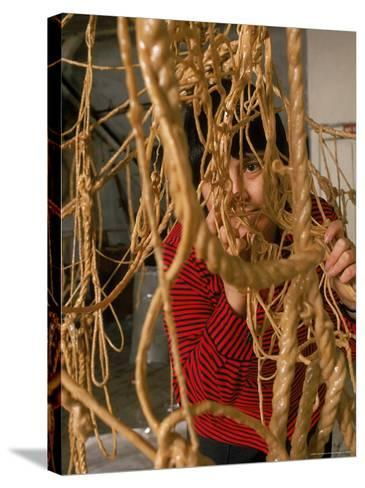 Eva Hesse Peering Through Her Sculpture of Rubber Dipped String and Rope-Henry Groskinsky-Stretched Canvas Print