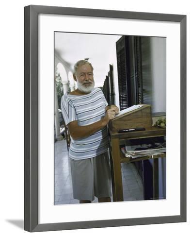 Ernest Hemingway at the Standing Desk on the Balcony of Bill Davis's Home Near Malaga-Loomis Dean-Framed Art Print