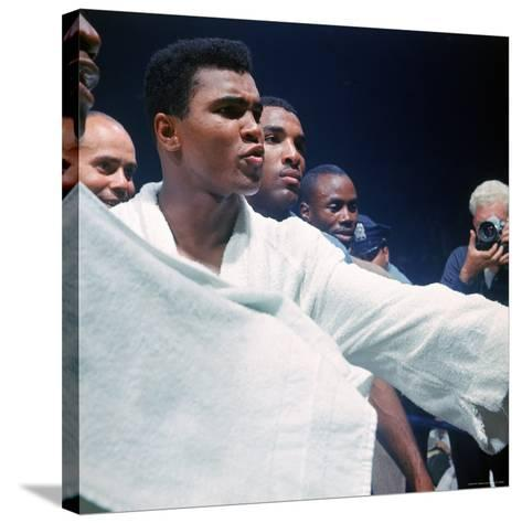 Heavyweight Boxer Cassius Clay, aka Muhammad Ali, After His Fight with Sonny Liston-John Dominis-Stretched Canvas Print
