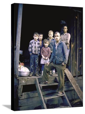 Unemployed Miner Standing with Family, Who Live on Social Security, Poverty in Appalachia-John Dominis-Stretched Canvas Print