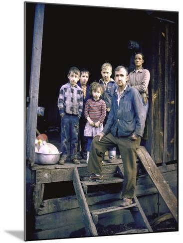 Unemployed Miner Standing with Family, Who Live on Social Security, Poverty in Appalachia-John Dominis-Mounted Photographic Print