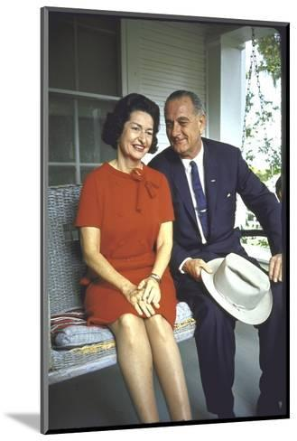 President Lyndon Johnson Sitting on Proch Swing with Wife on Morning Following His Election Win-John Dominis-Mounted Photographic Print