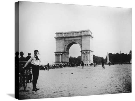Boy on Bike as Hundreds Ride Bikes Through the Arch at Prospect Park During a Bicycle Parade-Wallace G^ Levison-Stretched Canvas Print