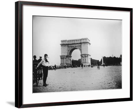 Boy on Bike as Hundreds Ride Bikes Through the Arch at Prospect Park During a Bicycle Parade-Wallace G^ Levison-Framed Art Print
