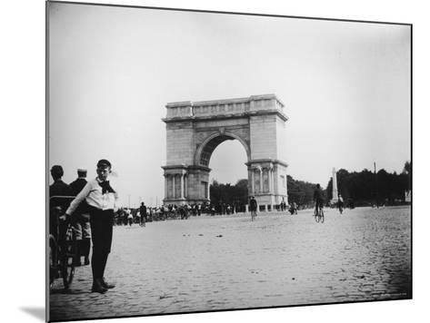 Boy on Bike as Hundreds Ride Bikes Through the Arch at Prospect Park During a Bicycle Parade-Wallace G^ Levison-Mounted Photographic Print