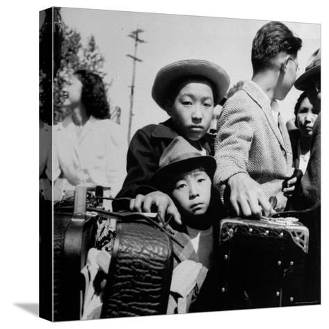 Evacuees of Japan Awaiting Turn for Baggage Inspection upon Arrival at Assembly Center During WWII-Dorothea Lange-Stretched Canvas Print