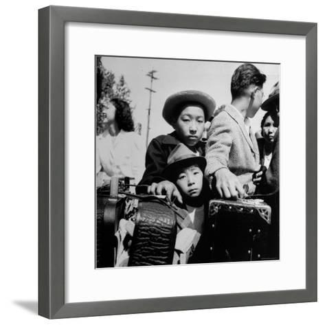 Evacuees of Japan Awaiting Turn for Baggage Inspection upon Arrival at Assembly Center During WWII-Dorothea Lange-Framed Art Print