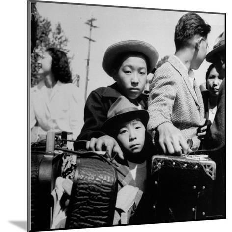 Evacuees of Japan Awaiting Turn for Baggage Inspection upon Arrival at Assembly Center During WWII-Dorothea Lange-Mounted Photographic Print
