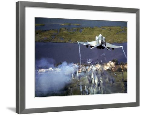 American F-4C Phantom Jet Streaming Contrails After Bombing Viet Cong Stronghold During Vietnam War-Larry Burrows-Framed Art Print