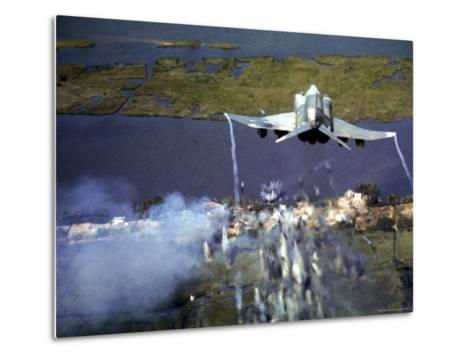 American F-4C Phantom Jet Streaming Contrails After Bombing Viet Cong Stronghold During Vietnam War-Larry Burrows-Metal Print