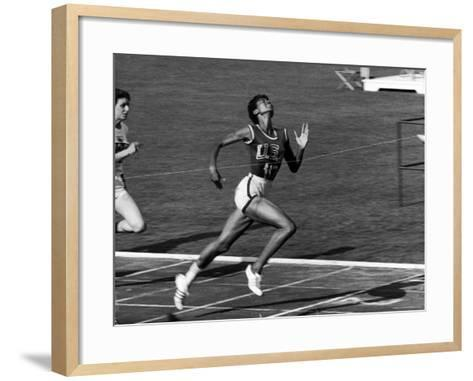 Wilma Rudolph, Across the Finish Line to Win One of Her 3 Gold Medals at the 1960 Summer Olympics-Mark Kauffman-Framed Art Print