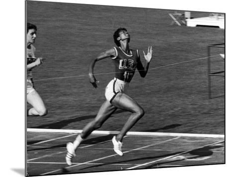 Wilma Rudolph, Across the Finish Line to Win One of Her 3 Gold Medals at the 1960 Summer Olympics-Mark Kauffman-Mounted Premium Photographic Print