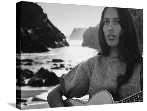 Folk Singer Joan Baez on the Beach with Guitar Near Her Home-Ralph Crane-Stretched Canvas Print