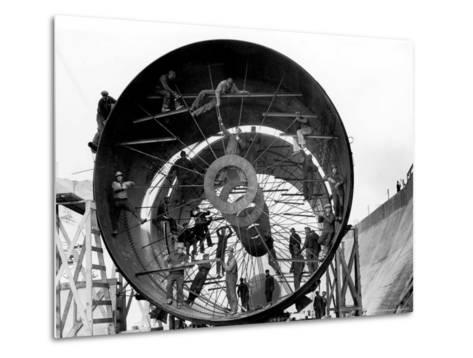 Men Working on Pipes Used to Divert Section of Missouri River During Building of Fort Peck Dam-Margaret Bourke-White-Metal Print