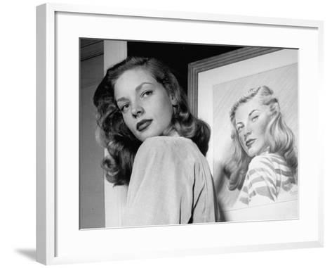 Actress Lauren Bacall Posing in Front of Portrait Drawing of Herself in Suite at the Gotham Hotel-Nina Leen-Framed Art Print