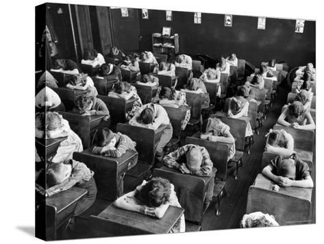 Elementary School Children with Heads Down on Desk During Rest Period in Classroom-Alfred Eisenstaedt-Stretched Canvas Print