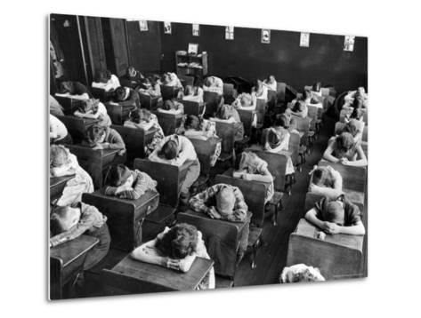 Elementary School Children with Heads Down on Desk During Rest Period in Classroom-Alfred Eisenstaedt-Metal Print