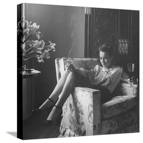 Actress Olivia de Havilland with Cigarette and Glass of Beer in While Relaxing at Home-Bob Landry-Stretched Canvas Print