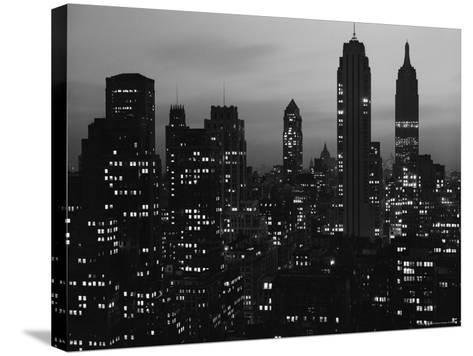 Silhouette of the Empire State Building and Other Buildings without Light During Wartime-Andreas Feininger-Stretched Canvas Print