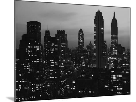 Silhouette of the Empire State Building and Other Buildings without Light During Wartime-Andreas Feininger-Mounted Photographic Print