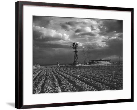 Dust Storm Rising over Farmer Walking Across His Plowed Field-Margaret Bourke-White-Framed Art Print