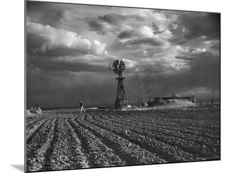 Dust Storm Rising over Farmer Walking Across His Plowed Field-Margaret Bourke-White-Mounted Photographic Print