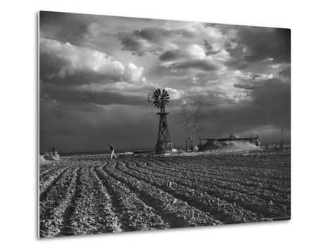 Dust Storm Rising over Farmer Walking Across His Plowed Field-Margaret Bourke-White-Metal Print