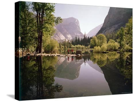 Children on Rocks on Mirror Lake in Yosemite National Park with Mountain Rising in the Background-Ralph Crane-Stretched Canvas Print